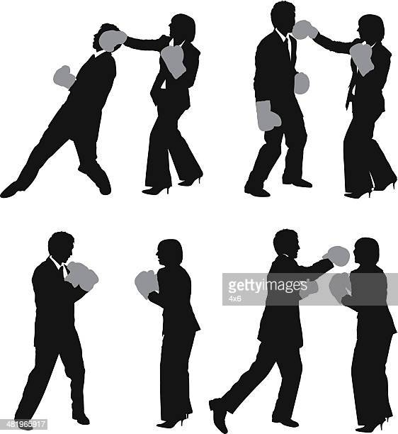 silhouette of business couples boxing - fighting stance stock illustrations, clip art, cartoons, & icons