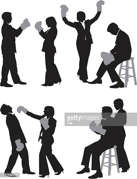 silhouette of business couples fighting - fighting stance stock illustrations, clip art, cartoons, & icons