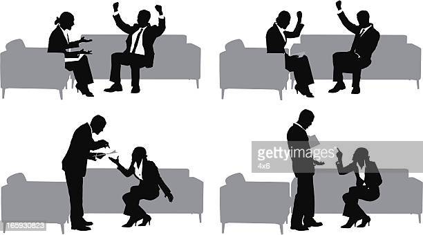 Silhouette of business couples in meeting