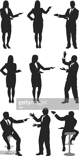 Silhouette of business executives gesturing