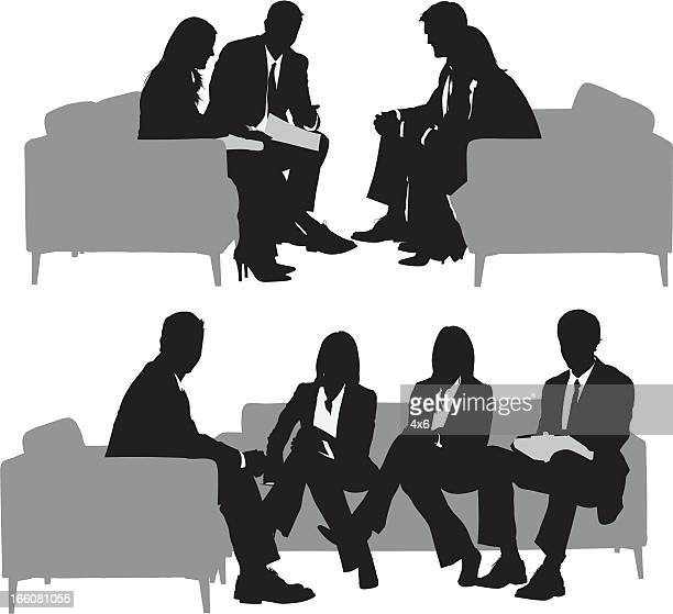 Silhouette of business executives in a meeting