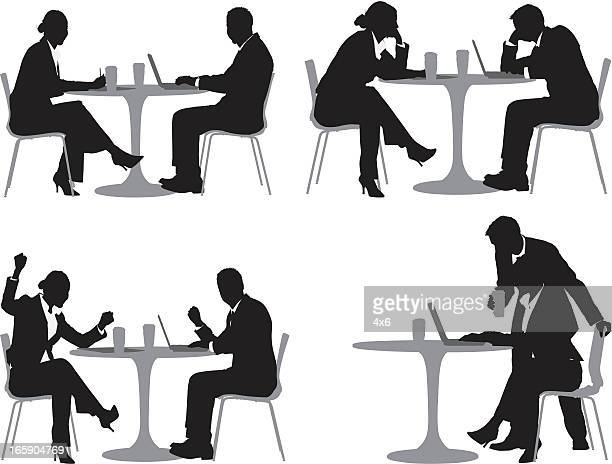 Silhouette of business executives in a restaurant