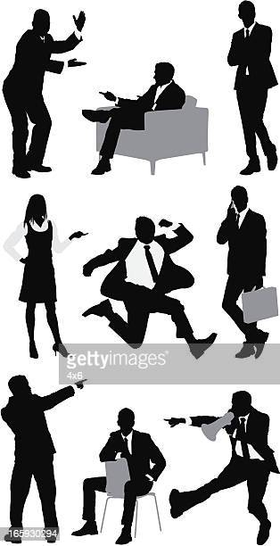 Silhouette of business executives in different action