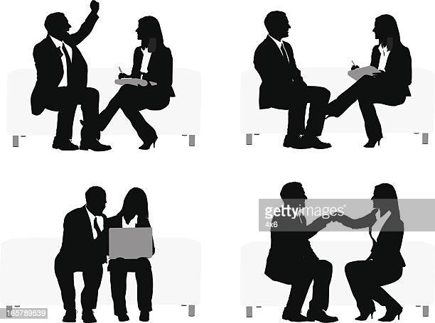 Silhouette of business executives sitting on couch