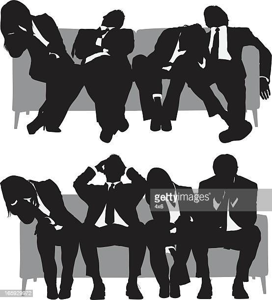 Silhouette of business people resting on couch