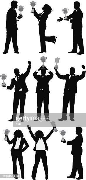 ilustrações, clipart, desenhos animados e ícones de silhueta de pessoas de negócios com um troféu - trophy