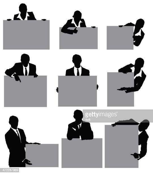 Silhouette der Geschäft Leute, die Schilder mit