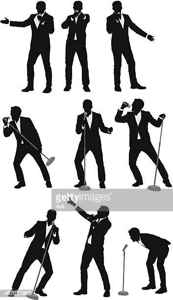 Silhouette of businessmen singing into microphones