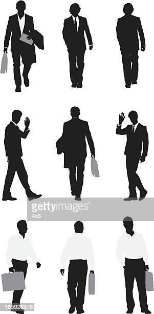 Silhouette of businessmen walking