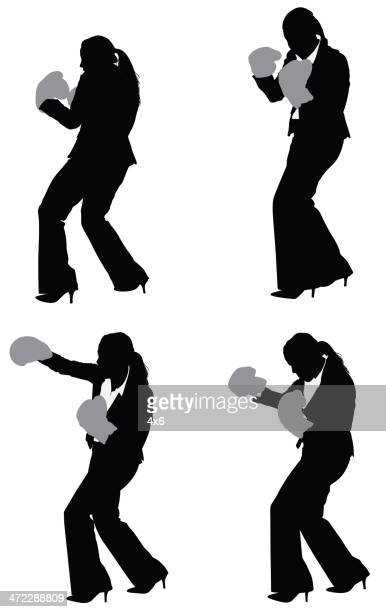 silhouette of businesswoman in fighting pose - fighting stance stock illustrations, clip art, cartoons, & icons