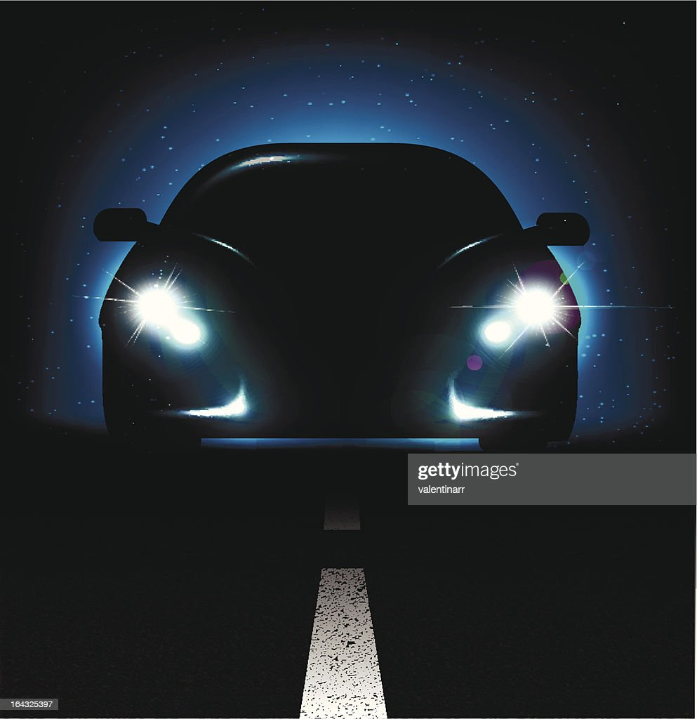 Silhouette of car with headlights on asphalt dark background.