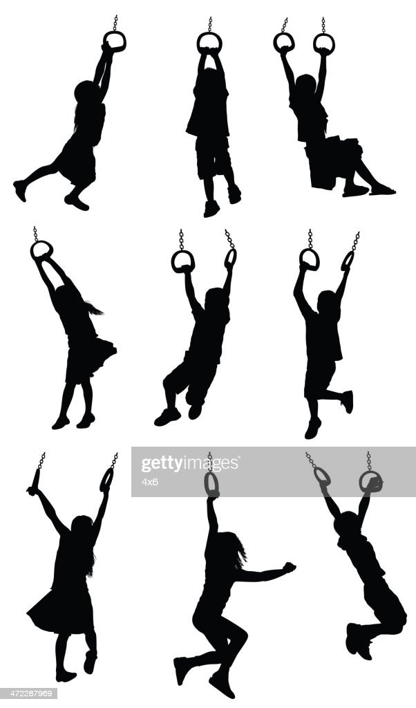 Silhouette of children hanging on gymnastic rings