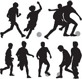 Silhouette of children playing soccer