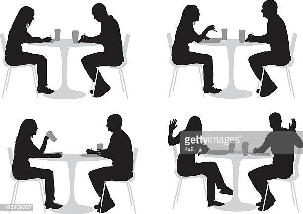 silhouette of couple in a restaurant - sitting stock illustrations