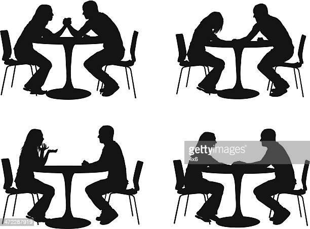 Silhouette der Paar in einem restaurant
