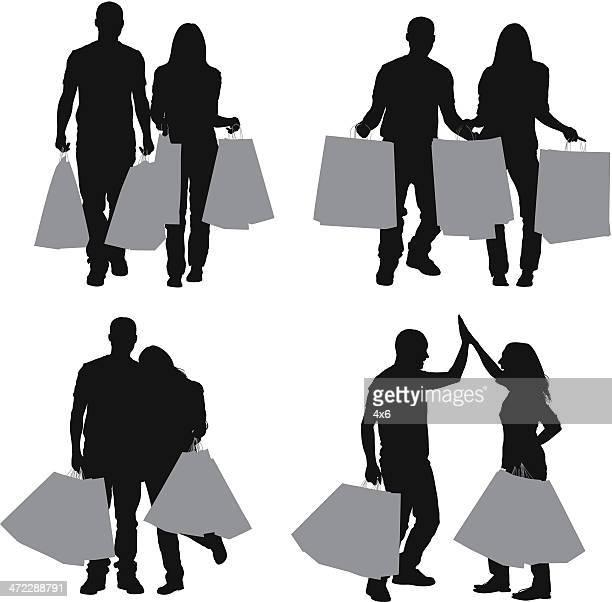 Silhouette der Paar mit Einkaufstasche
