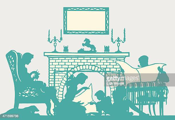 Silhouette of Family in Front of Fire
