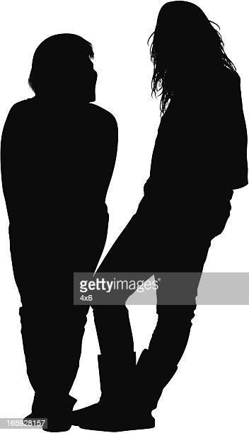 Silhouette of female friends