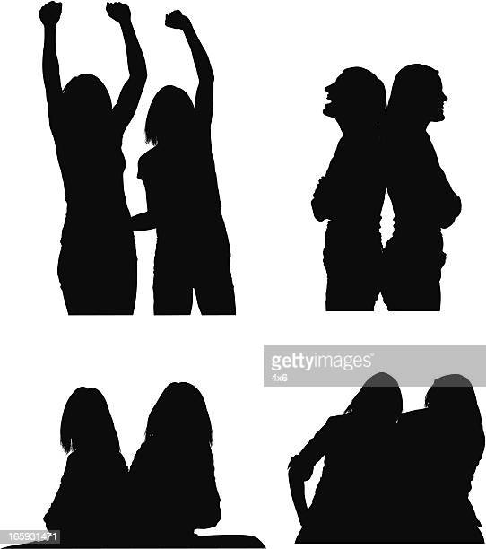 silhouette of female friends - back to back stock illustrations, clip art, cartoons, & icons