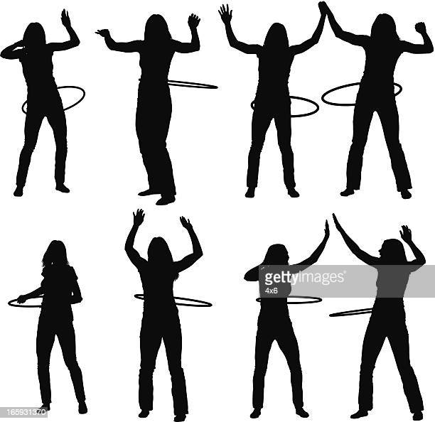 silhouette of female friends with plastic hoops - contortionist stock illustrations