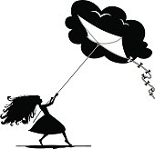 Silhouette of girl holding kite. lifestyle concept