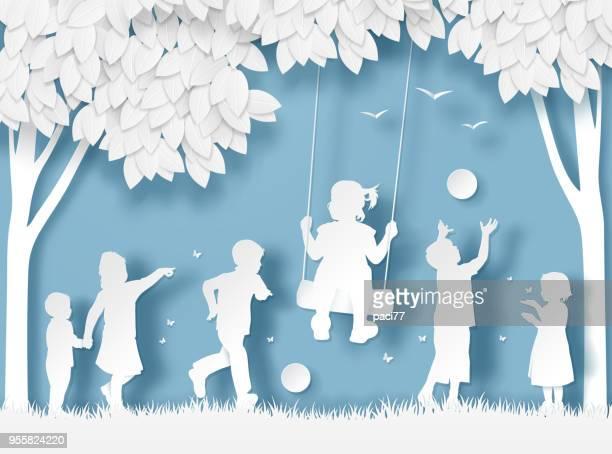 silhouette von glücklichen kindern spielen. scherenschnitt-stil - papierhandwerk stock-grafiken, -clipart, -cartoons und -symbole