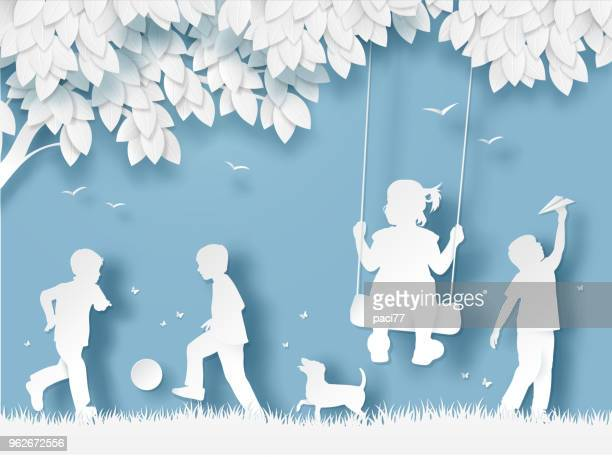 silhouette of happy children playing. paper cut style - child stock illustrations