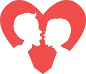 Silhouette of kissing couple in red heart