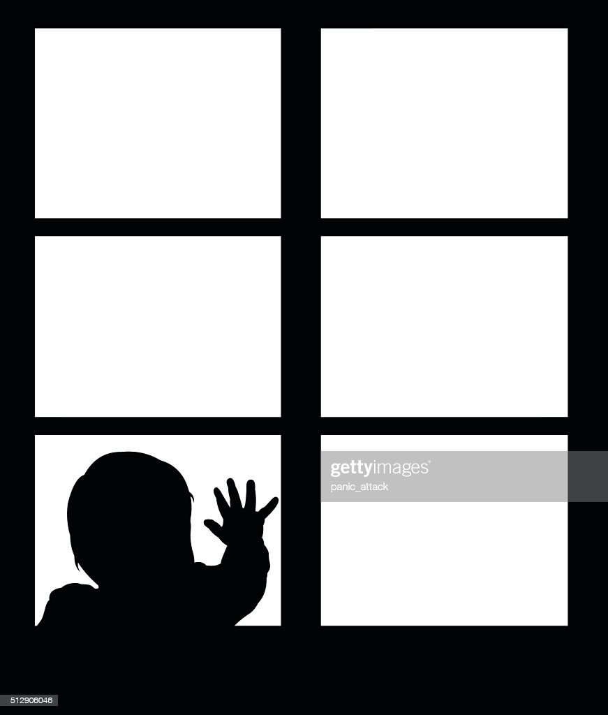 Silhouette of little baby waving hand on the window.