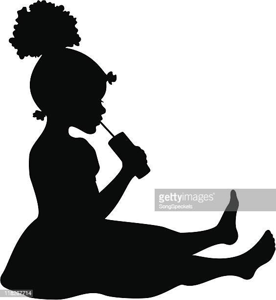 Silhouette of Little Girl Sipping from a straw