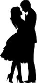 Silhouette of loving couple hugging