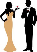 Silhouette of man and woman holding a cocktail