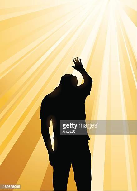 silhouette of man praying in the midst of yellow sun rays - praying stock illustrations, clip art, cartoons, & icons