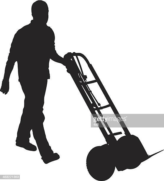 silhouette of man pushing a handtruck - hand truck stock illustrations, clip art, cartoons, & icons