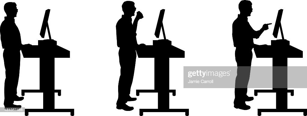 Silhouette of man standing at stand up desk : stock illustration