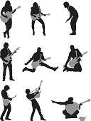 Silhouette of musicians playing guitar