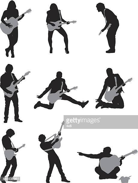 silhouette of musicians playing guitar - guitarist stock illustrations, clip art, cartoons, & icons