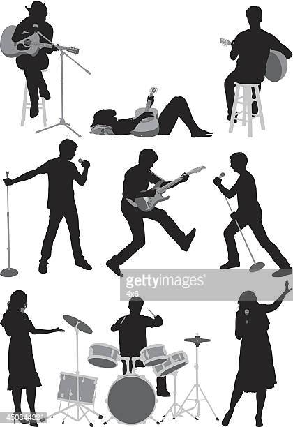 silhouette of musicians - guitarist stock illustrations, clip art, cartoons, & icons