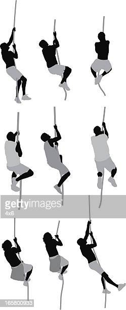 silhouette of people climbing rope - medium group of people stock illustrations