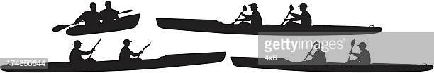 Silhouette of people kayaking
