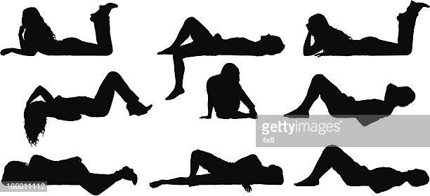 silhouette of people lying and siting on ledge - lying on back stock illustrations, clip art, cartoons, & icons