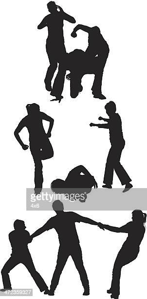 silhouette of people on fighting - gang stock illustrations