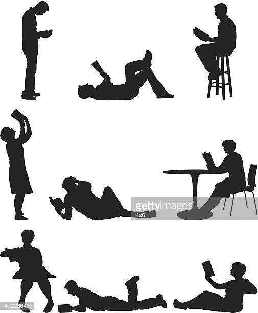 silhouette of people reading books - lying on front stock illustrations, clip art, cartoons, & icons