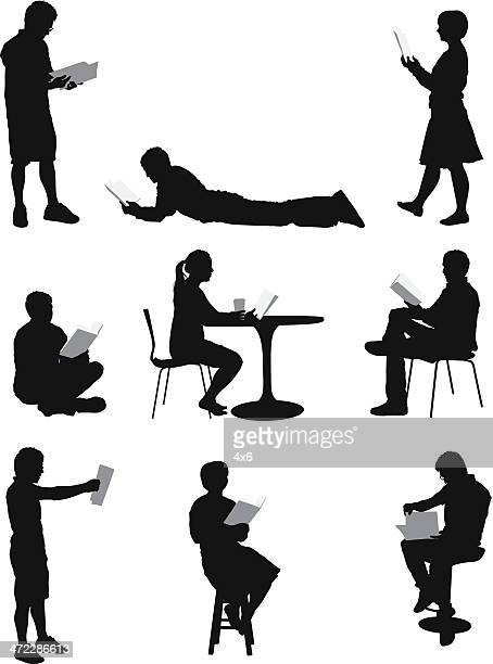 silhouette of people reading - lying on front stock illustrations, clip art, cartoons, & icons