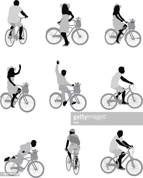 Silhouette of people riding bicycle