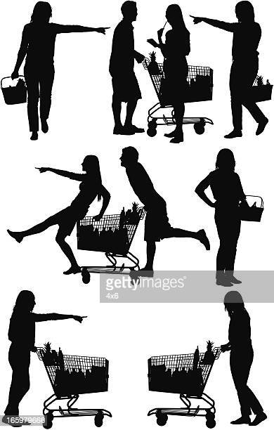Silhouette of people shopping in a supermarket