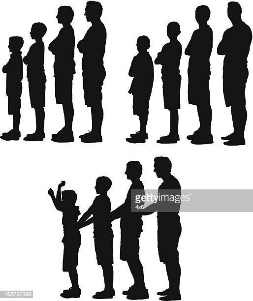 Silhouette of people standing in a row