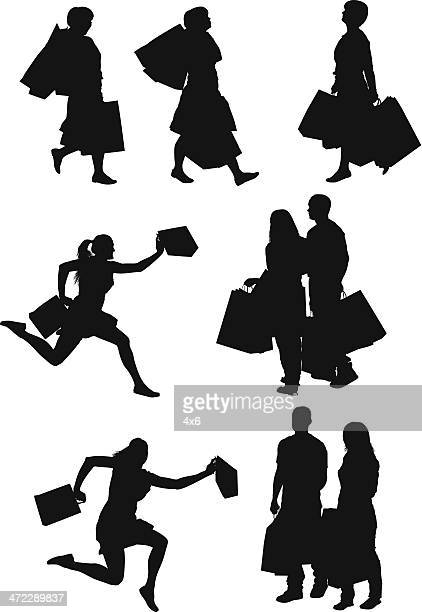 silhouette of people with shopping bags - spending money stock illustrations, clip art, cartoons, & icons