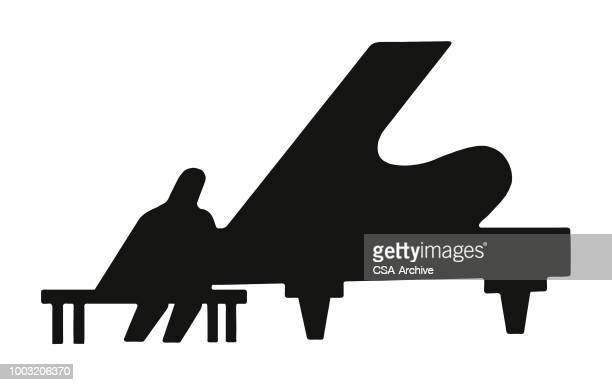Silhouette of Pianist and Grand Piano