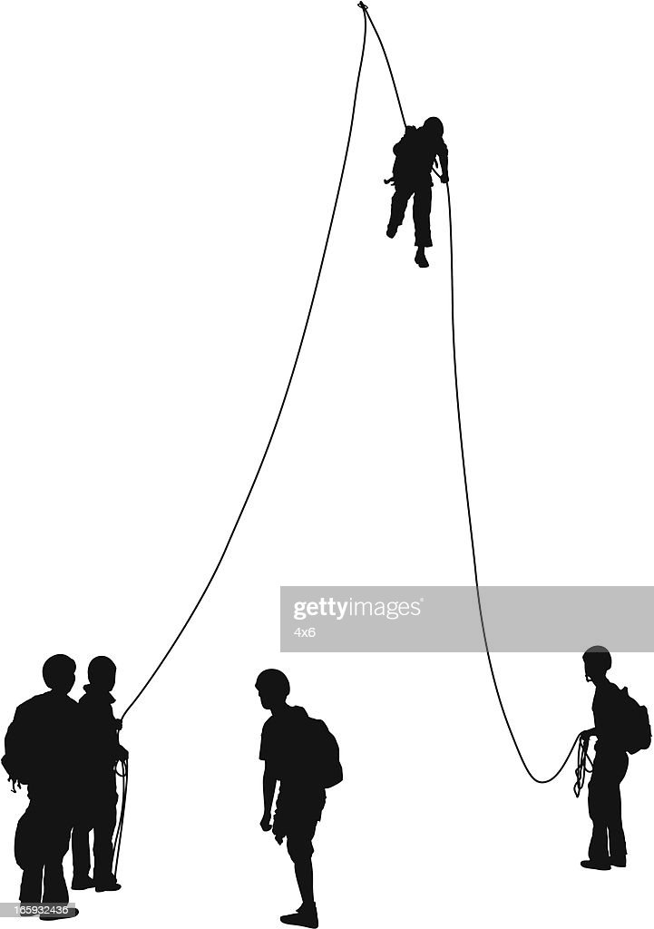 Silhouette of rock climbers